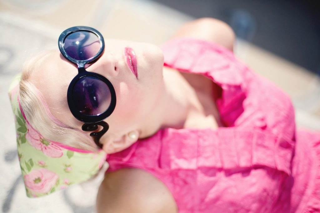 woman with sunglasses out in the sun