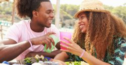 African-American couple outside eating