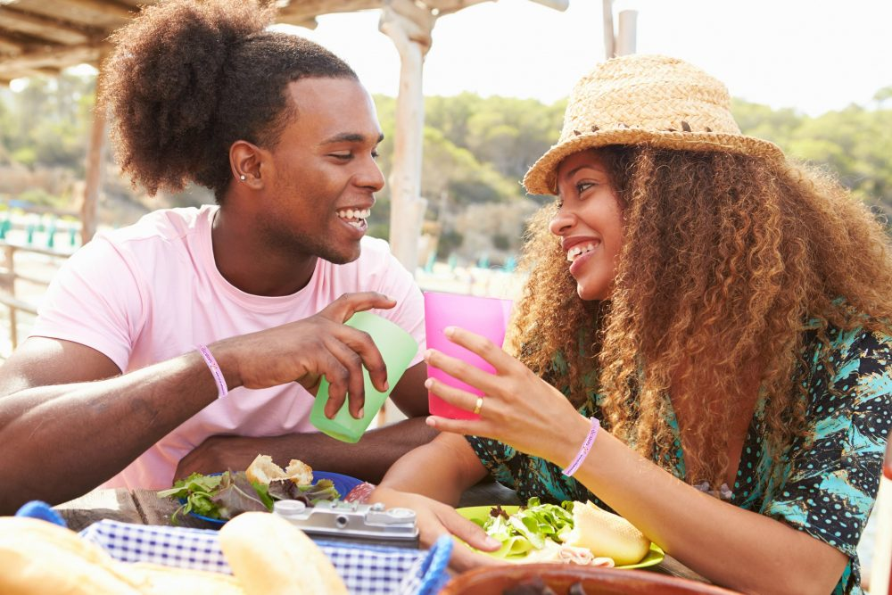 African American couple eating outside